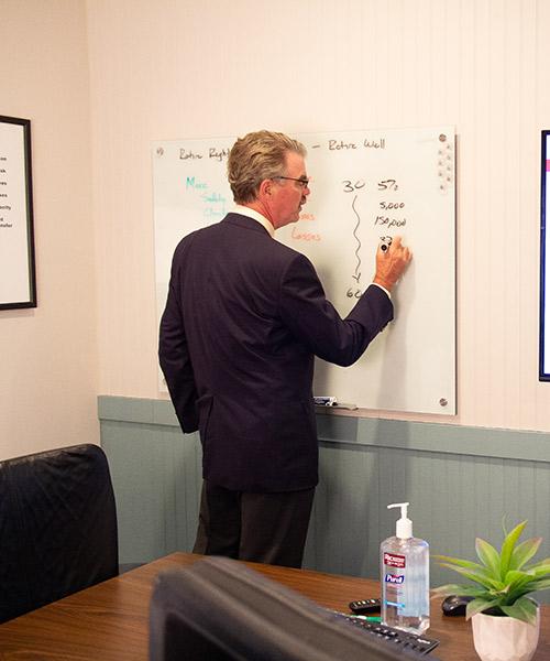 Mark Coker do calculations on a board